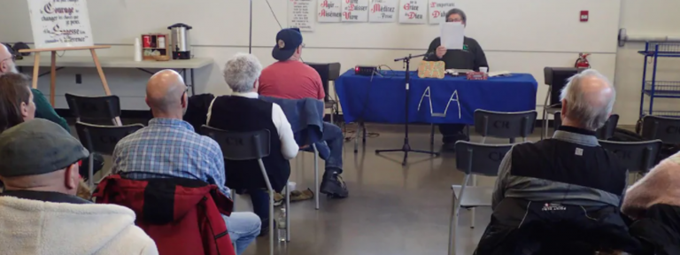 Adults sitting at an AA meeting