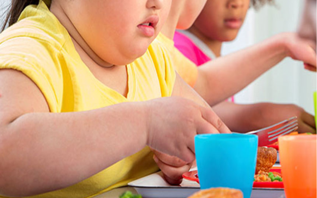 obese child eating