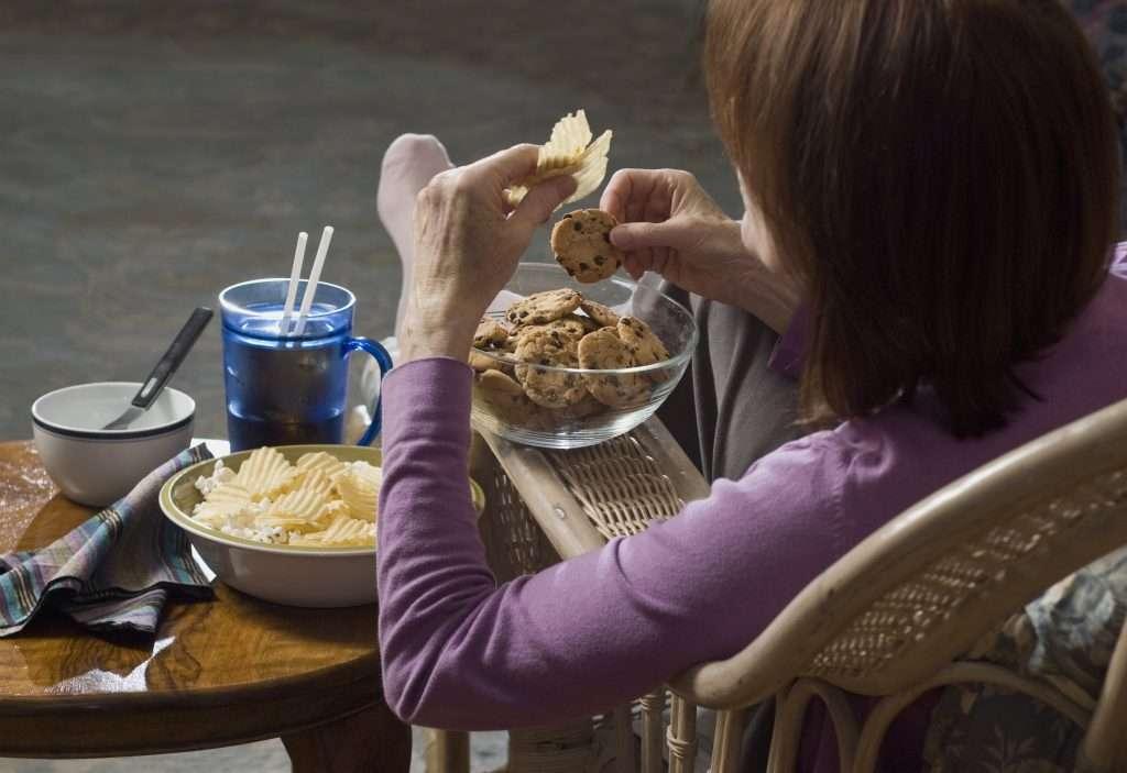 adult eating junk food