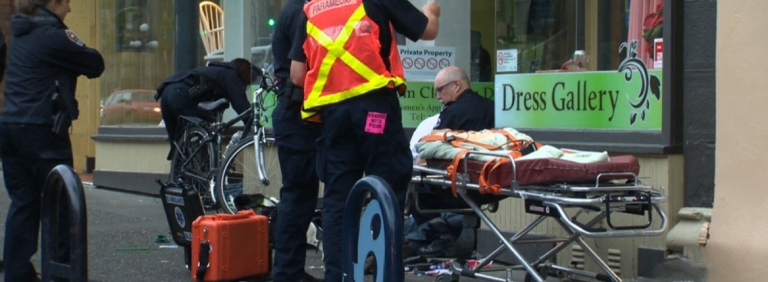 street scene with first responders to an overdose