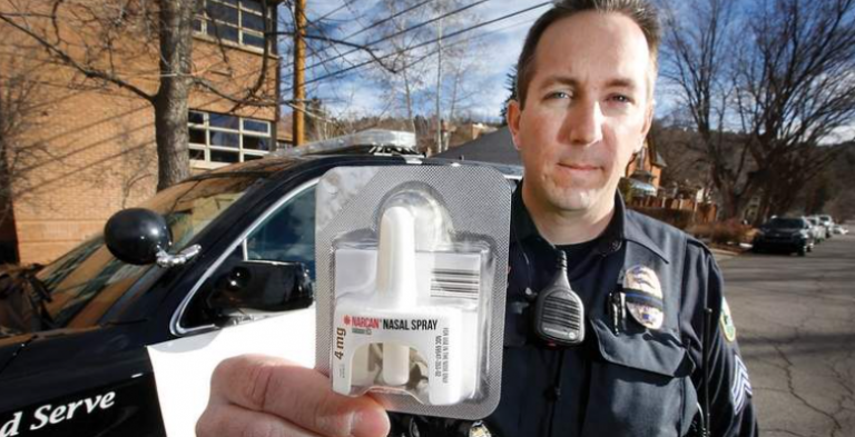 Police officer holding Narcan