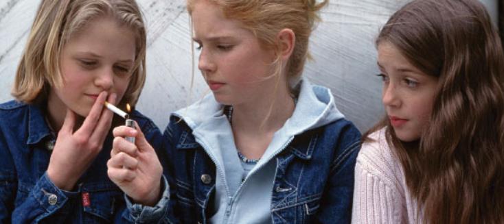 teenaged girls smoking cigarette
