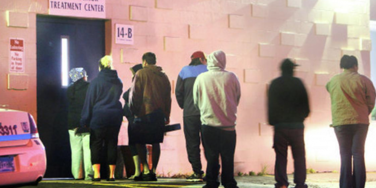 Line of people waiting outside a methadone clinic