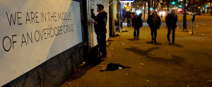 street scene in Ontario Canada with opioid crisis message