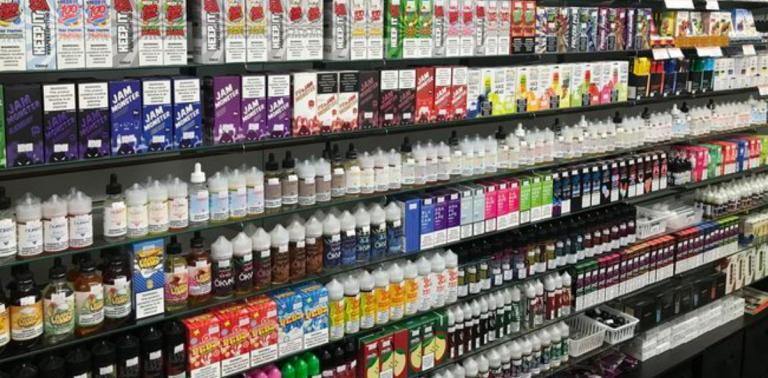 flavored vape liquids on display